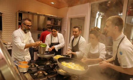 Massimo Bottura with Mirazur's Mauro Colagreco (second left) and other chefs at Refettorio Ambrosiano.
