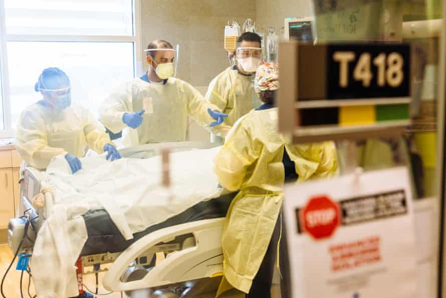 Medical workers at Community medical center in Fresno county care for a coronavirus patient in the intensive care unit.