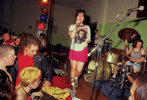 Kathleen Hanna and Tobi Vail on stage in 1995.
