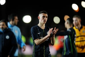 Manchester City's double goalscorer Phil Foden applauds the fans.