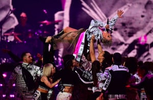 Pink is carried aloft in her closing performance.
