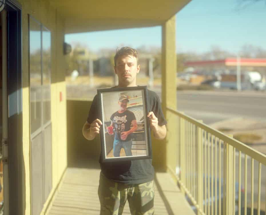 Devon Reiss holds a portrait of his father, Kenneth Reiss, outside of his apartment. 'There is a systematic problem here in Albuquerque, where police officers, deputy sheriffs, people in law enforcement, are not held accountable,' said Sam Bregman.