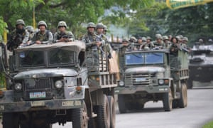 Philippine marines in tanks advancing on a militant base in the city of Marawi