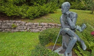 A statue of James Joyce at his grave in the Fluntern cemetery, Zurich