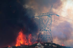 Powerlines in the path of an approaching fire in Jamul