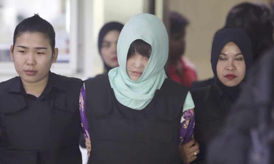 Vietnamese national Doan Thi Huong (centre) is escorted from the court in Malaysia