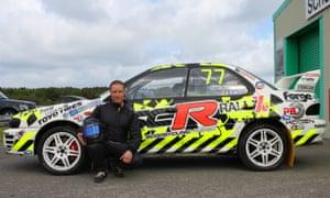 Dmitrij Sribnyj with the rallycross car he races.