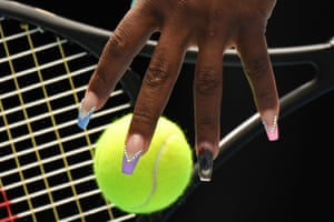 A nail painting of a koala bear can be seen as Serena Williams practices her serve