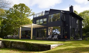 Island life: the 'off-black'-painted west-facing house with floor-to-ceiling windows.