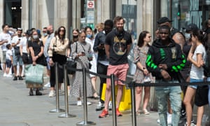 Customers wait in line to enter Topshop on Oxford Street, London, on 15 June, 2020
