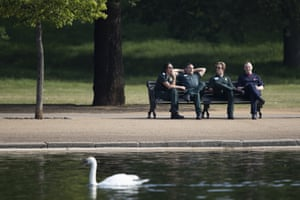 An ambulance crew take a break next to the Serpentine in Hyde Park in London, UK