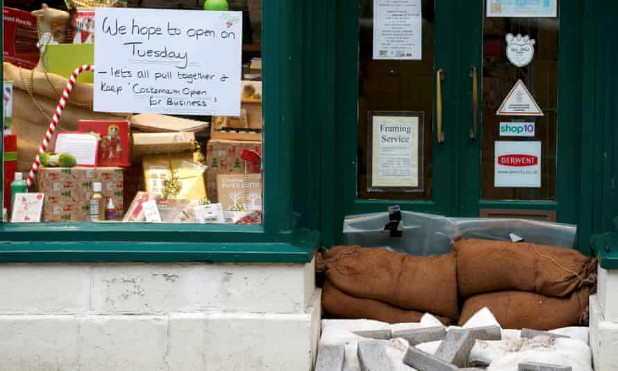 A sign to customers on the window of a business in Cockermouth on Monday