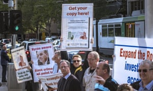Protesters rally outside the commonwealth law courts in Melbourne for the banking royal commission's hearings.