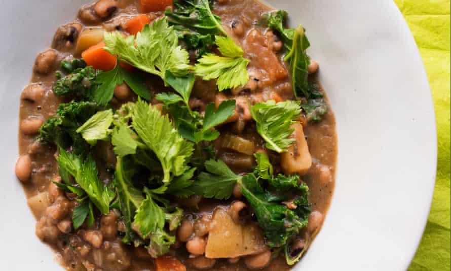 Black-eyed bean, rosemary and kale soup in a large white bowl