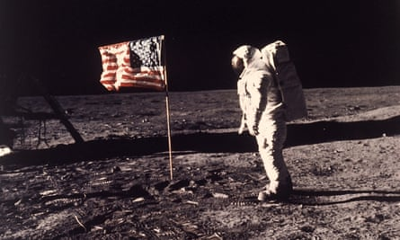 Buzz Aldrin with a nylon US flag planted on the moon in 1969.