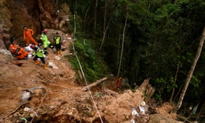 Rescue workers install a rope lane during evacuation process after the landslide of the illegal gold mine at Bolaang Mongondow Regency in North Sulawesi, Indonesia