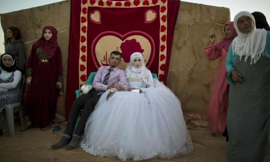 Syrian refugees during their wedding ceremony at a tented settlement in Jordan this year.