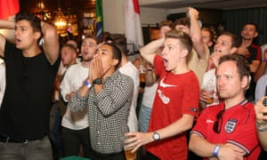 England fans watch the team play Belgium, at the Lord Raglan pub in central London.