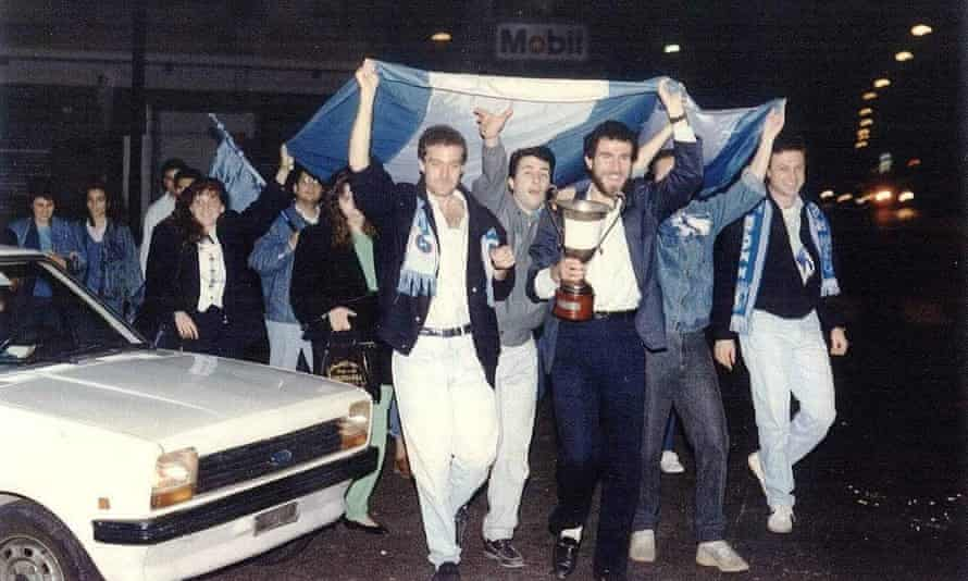 Sergio Travi ( left, under the flag) celebrating with his friends after Napoli won the UEFA CUP in 1989.