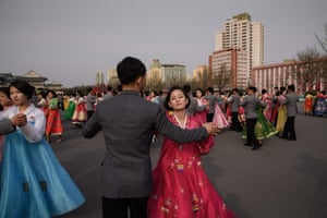 Students participate in a mass dance event outside the indoor stadium in Pyongyang.