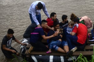 Migrants use a makeshift raft to cross the Suchiate river to Ciudad Hidalgo in Mexico.