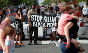 Protesters gather at the scene where George Floyd was pinned down by a police officer kneeling on his neck in Minneapolis, Minnesota, on 26 May.