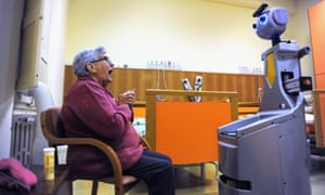 A robot acts as a caregiver or butler for guests at a home for elderly people in Italy.