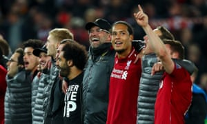 Jürgen Klopp linked arms with his players and staff after the final whistle
