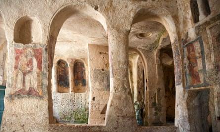 Underneath the arches: frescoes in a rock church.