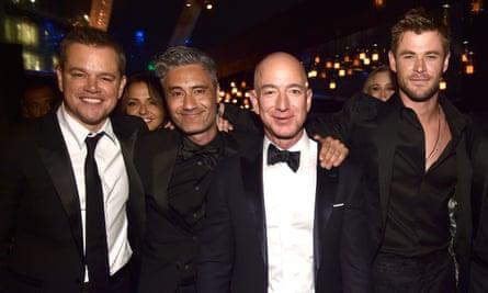 Matt Damon, Taika Waititi, Jeff Bezos and Chris Hemsworth wear black at the Golden Globes.