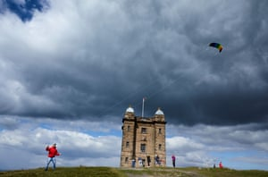 Rob Chernick, one of the hundreds of participants at the annual Kites at the Cage, an opportunity for the public to join a mass flying of kites around the Cage, an 18th century former hunting lodge at Lyme Park in Cheshire
