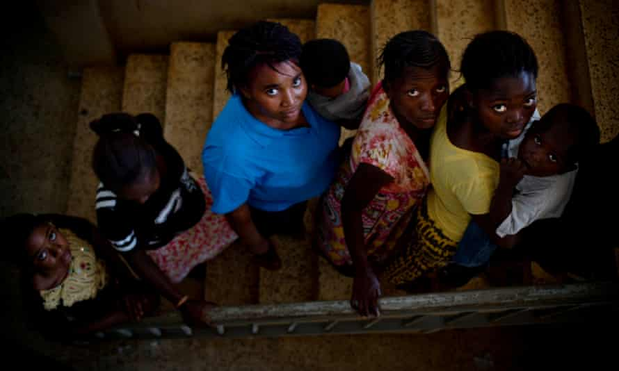 Unmarried mothers pose with their children in Freetown