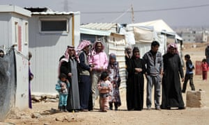 Syrian families watch during a visit to the Zaatari refugee camp, which shelters some 80,000 Syrian refugees on the border with war-ravaged Syria, by United Nations Secretary General on March 28, 2017. Syria's devastating civil war, now in its seventh year, has rendered more than half the country's population refugees. The conflict has left more than 320,000 people dead, according to the Syrian Observatory for Human Rights.  / AFP PHOTO / THOMAS COEXTHOMAS COEX/AFP/Getty Images