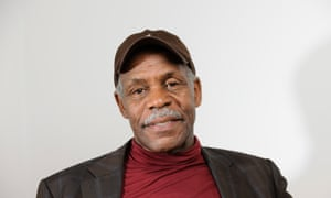 The actor Danny Glover, whose photograph was used on FLF's website, making out he was founder Dennis Abiola.