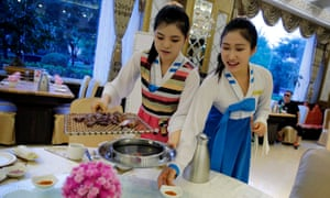 North Korean waitresses serve guests at a restaurant in Beijing, China. The US has called for all countries not to host 'guest workers' from Kim Jong-un's regime.