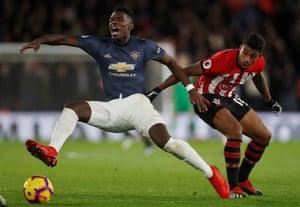 Paul Pogba is takemn down by Southampton's Mario Lemina.