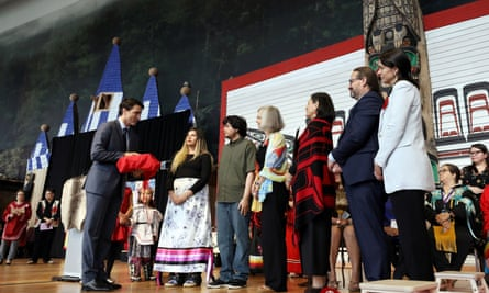 Canada's prime minister, Justin Trudeau, is presented with the final report during the closing ceremony of the National Inquiry into Missing and Murdered Indigenous Women and Girls in Gatineau, Quebec, on Monday.