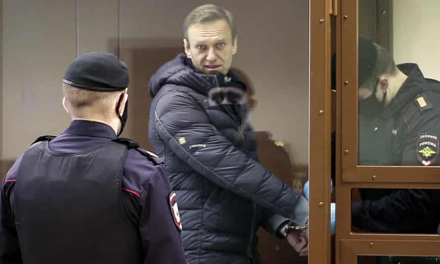 Alexei Navalny in a glass cell during a court hearing in Moscow.