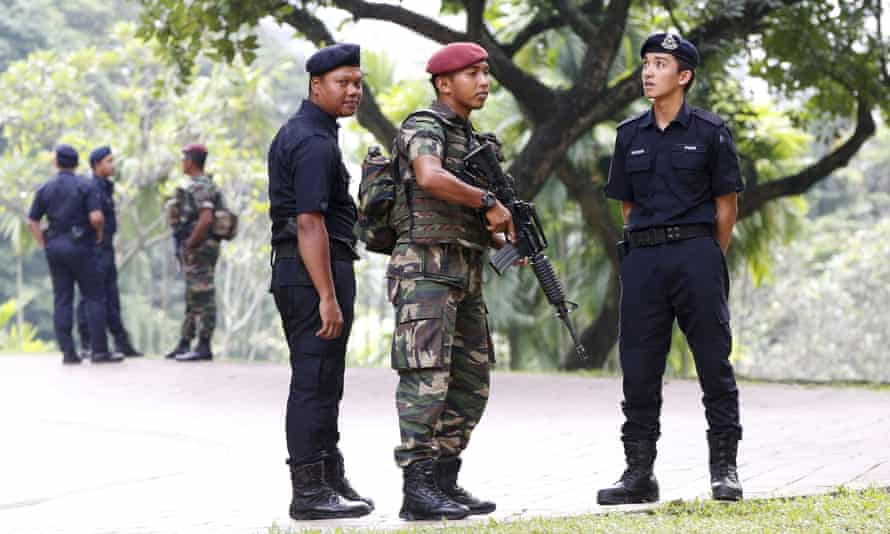 Members of the military and police patrol outside the venue for the 27th ASEAN summit in Kuala Lumpur. Security has been stepped up follow attacks by Islamic State in Paris.