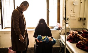 Parents watch over their child at the Sabeen maternity hospital in Sana'a.