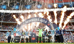 FA Cup Final - Manchester City v Watford<br>Soccer Football - FA Cup Final - Manchester City v Watford - Wembley Stadium, London, Britain - May 18, 2019  Manchester City's Vincent Kompany lifts the trophy as they celebrate after winning the FA Cup  Action Images via Reuters/John Sibley     TPX IMAGES OF THE DAY