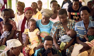 A community outreach organised by Reproductive Health Uganda for rural residents to receive family planning counselling and treatment.