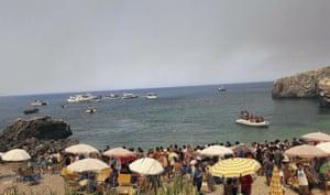 San Vito Lo Capo, Italy Tourists are evacuated by boat