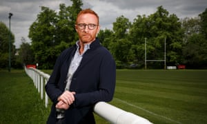 Ben Ryan poses for a photograph on the side of a rugby pitch