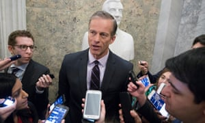Senator John Thune is surrounded by reporters