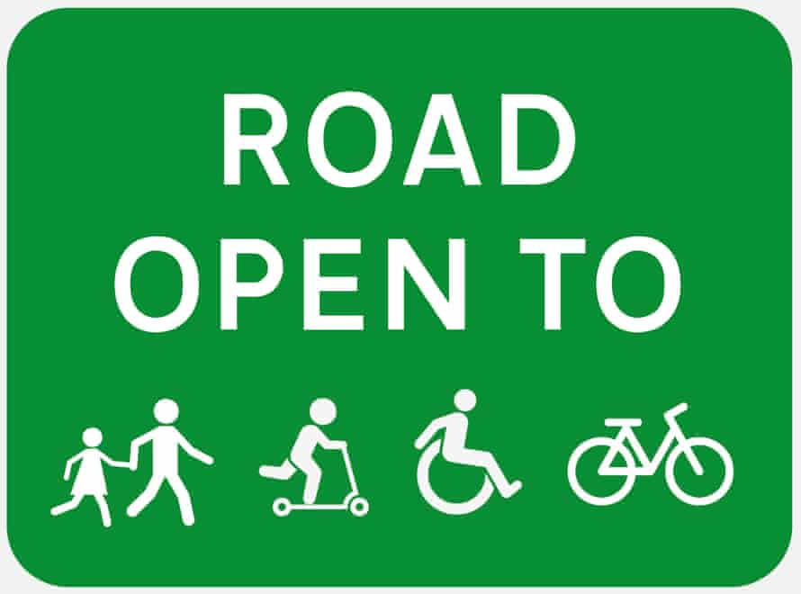 Road open to pedestrians, scooter users, wheelchair users and cycles sign