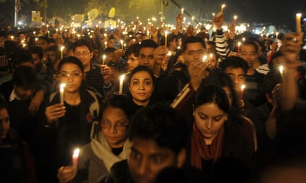 Indian protesters hold candles during a rally in New Delhi, following the gang rape of student Jyoti Singh