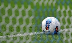 Football behind net