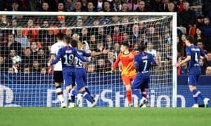 Kepa Arrizabalaga watches Daniel Wass's shot go over his head and into the net
