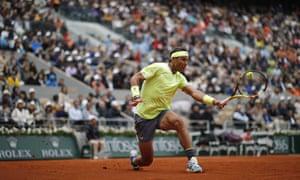 Rafael Nadal plays a backhand return to Roger Federer.